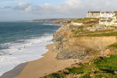 Loe Bar, Porthleven. With waves breaking on a sandy beach on a sunny december day Stock Photo
