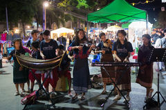LOEI, THAILAND - DECEMBER 31: Child group from Moradokmai Homeschool play music at loei steer night maket on Decamber, 2016 in lo royalty free stock images