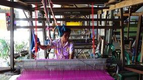 Thai weaves silk fabric. Loei, Thailand - September 24: An unidentified Thai weaves silk fabric on wooden weaving loom machines on September 24, 2016 in Loei stock video footage