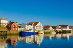 Lofoten - fisherhouses in evening light reflecting in water Stock Photos