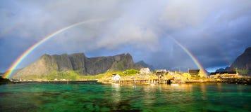 Lofoten fishing village with rainbow Stock Photos