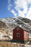 Lofoten house against the blue sky and mountains Royalty Free Stock Photography