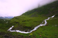 Lofoten islands. River running through valley in lofoten islands Royalty Free Stock Photo