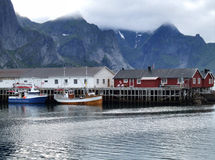 Lofoten islands fishing harbor village. Village on the water. Fishing harbor Royalty Free Stock Image