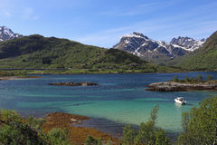 Lofoten landscape. Landscape with fjord, mountains, boat and bridge on Lofoten islands, Norway Royalty Free Stock Photo