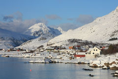 Lofoten mountains and fjords. The small village of Sund in a fjord surrounded by the mountains stock photography