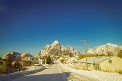 LOFOTEN, NORWAY, APRIL, 10, 2018: Outdoor view of frozen street with some buildings in every side of the road in. LOFOTEN, NORWAY, APRIL, 10, 2018: Outdoor view stock photos