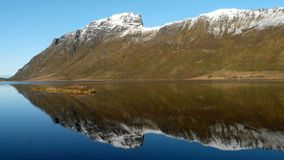 Lofoten's arrow. Hill reflecting in a Lofoten's fjord stock photo
