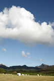 Lofoten's clouds and hay bales Royalty Free Stock Photos