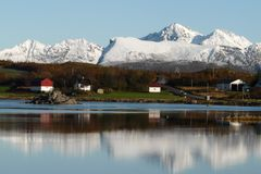 Lofoten's mountains reflecting in the fjord royalty free stock images