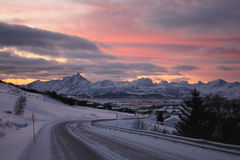 Lofoten's road. The road from Stamsund to Leknes, Lofoten islands, enlighted by the first sun after arctic darkness stock photos
