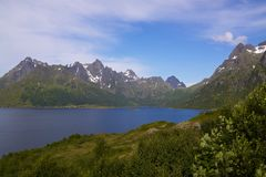 Lofoten scenery. Picturesque scenery on Lofoten Islands with fjord and steep rocky mountains Royalty Free Stock Images