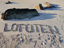 Lofoten, sign in the sand on the beach Stock Photography
