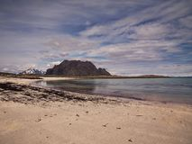 Lofoten by summer in Norway. A Nice scene from Lofoten, Norway. By the sandy Beach With the Cold water stock photo