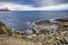 Lofotens Scenery with Group of Islands Against Snowy Mountains on Background. Royalty Free Stock Photo