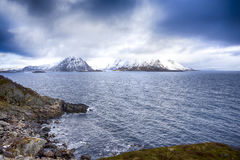 Lofotens Scenery with Group of Islands Against Snowy Mountains on Background Stock Photos