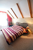 Loft or attic bedroom with slanted roof Royalty Free Stock Images