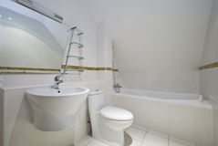 Loft bathroom. With angled ceiling bath tub toilet and sink Stock Photography