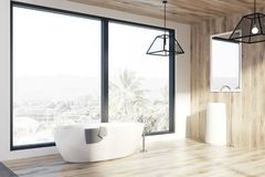 Loft bathroom, light wooden walls, a tub, side. Modern bathroom interior with a light wooden floor and walls, a sink with a mirror and a white roundish tub near royalty free illustration