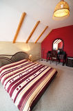 Loft bedroom. A modern loft bedroom with a double bed stock photo