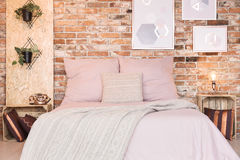 Loft bedroom with double bed Stock Photos
