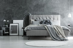 Loft bedroom with gray design royalty free stock photo