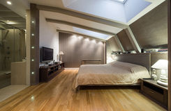 Loft bedroom with private bathroom Royalty Free Stock Photo