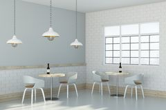 Loft cafe interior. Side view of loft cafe interior with furniture, window and lamps. 3D Rendering Royalty Free Stock Photography