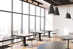 Loft cafe interior. With white walls, a wooden floor, round and square tables and metal chairs. 3d rendering mock up Stock Images