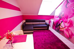 Loft conversion with orchid theme decoration Stock Photography