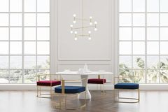 Loft dining room, blue and red chairs Stock Photos