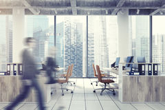 Loft downtown office, beige chairs, people Royalty Free Stock Photo