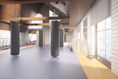 Loft gym interior. Creative new loft gym interior with equipment, city view and daylight. 3D Rendering. Fitness concept Royalty Free Stock Images