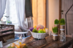 The loft-house is decorated for Easter. Easter decor home. Festive mood in a beautiful house with greenery, colorful eggs, garland Royalty Free Stock Images
