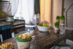 The loft-house is decorated for Easter. Easter decor home. Festive mood in a beautiful house with greenery, colorful eggs, garland Stock Photography