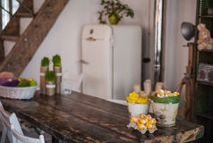 The loft-house is decorated for Easter. Easter decor home. Festive mood in a beautiful house with greenery, colorful eggs, garland Royalty Free Stock Image