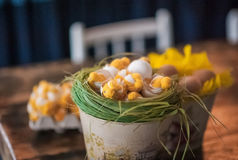 The loft-house is decorated for Easter. Easter decor home. Festive mood in a beautiful house with greenery, colorful eggs, garland Stock Image