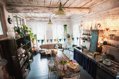 The loft-house is decorated for Easter. Easter decor home. Festive mood in a beautiful house with greenery, colorful eggs, garland royalty free stock photography