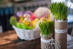 The loft-house is decorated for Easter. Easter decor home. Festive mood in a beautiful house with greenery, colorful eggs, garland Stock Photos