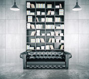 Loft interior with a library, a beautiful leather sofa  Stock Image