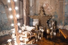 Loft interior with mirror, candles, brick wall, large window, living room in modern design.  Royalty Free Stock Photography