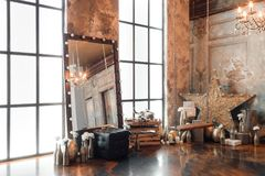 Loft interior with mirror, candles, brick wall, large window, living room in modern design.  Stock Images