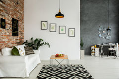 Loft interior with open room. Loft interior with open living room and simple home office Stock Image