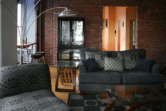 Loft living room. With brick wall and furniture Royalty Free Stock Images
