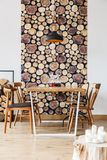 Loft with log rustic decor. Rustic home decor of dining space in loft interior with wooden table and log wallpaper stock image