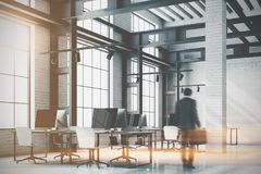 Loft office corner, computer screens toned Royalty Free Stock Photography