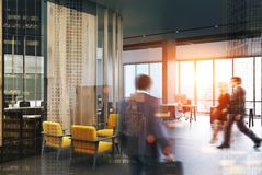 Gray loft office and waiting room, yellow toned. Loft office interior with a concrete floor and columns, a meeting room in the background and yellow armchairs in Royalty Free Stock Photo