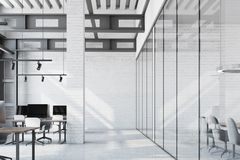 White brick loft office, column. Loft office interior with a white table, white brick walls, loft windows and rows of computer tables with black screens. A royalty free illustration