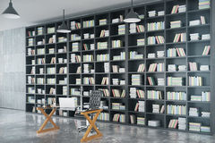 Loft private office with big book case, glassy table and concret Royalty Free Stock Photography