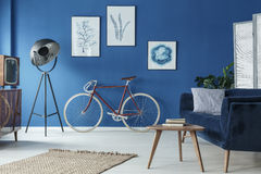 Loft in retro style. Spacious blue loft interior designed in retro style Stock Photos